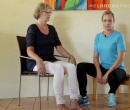 Seated knee stretch